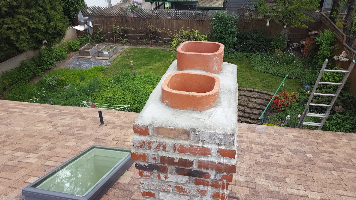 New crown poured on top of a chimney, has new flue tiles embedded in the crown.