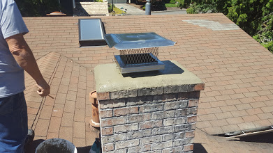 A new crown of sand and cement is poured on top of a chimney. A new stainless steel rain cap is installed.