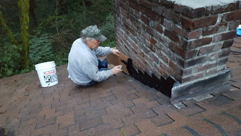 Chimney flashing being installed