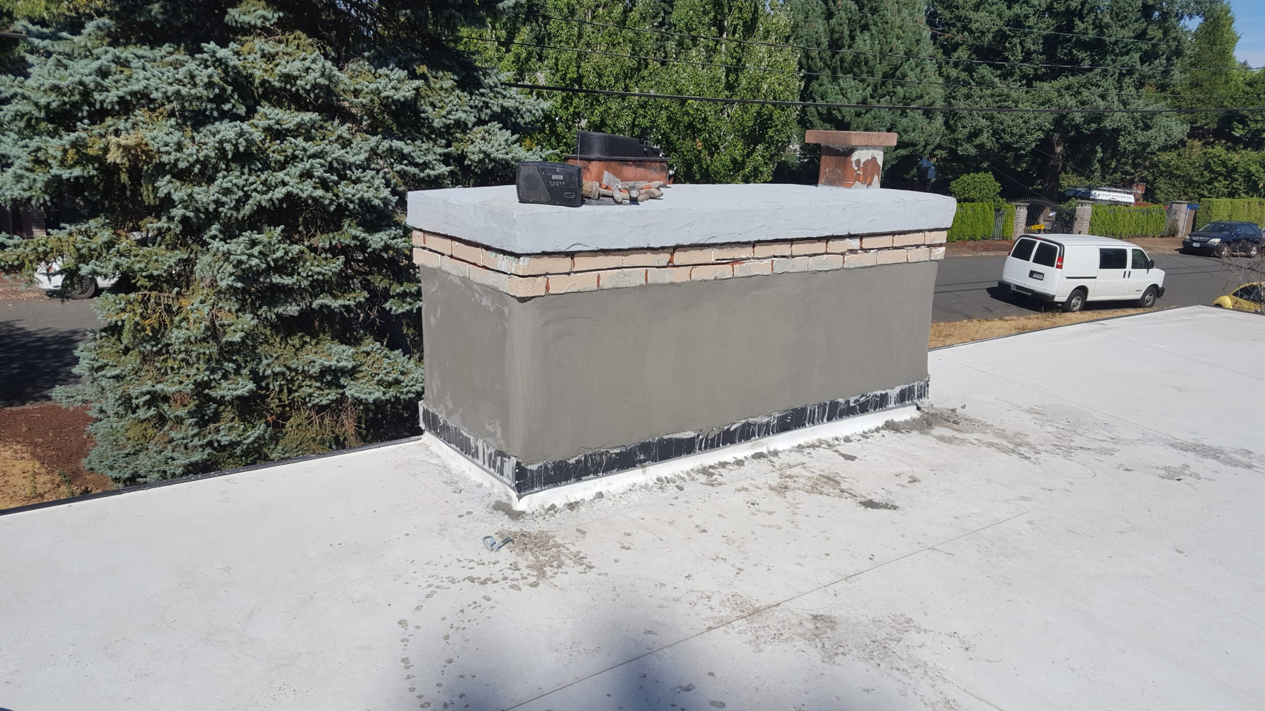 The final, smooth finish coat of stucco applied to a chimney.