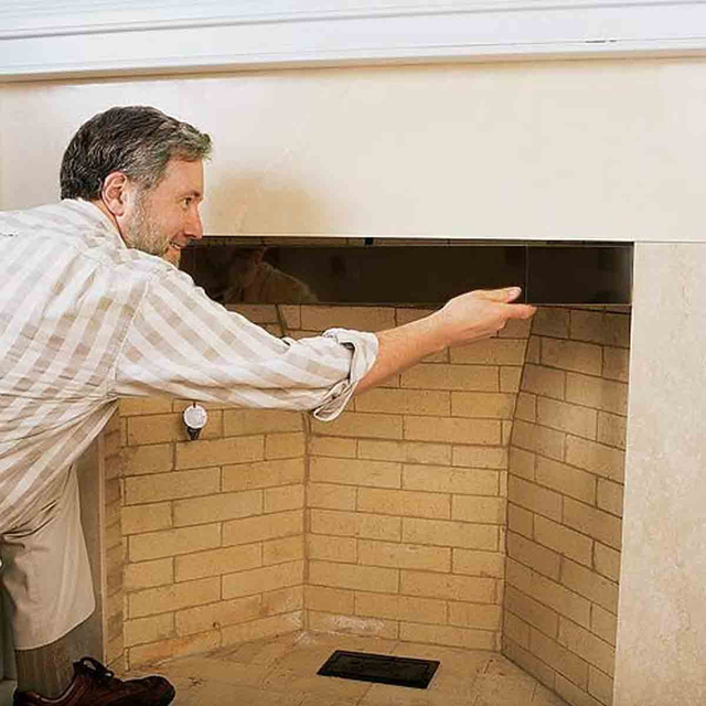 Fireplace smoke guard. This affixes to the top of the fireplace opening to keep smoke from rolling out of the top of the fireplace opening.