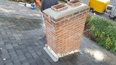 A completed tuckpoint repair of a chimney.